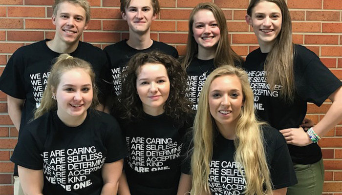 Dow High School students with t-shirts created for the Week of Nonviolence